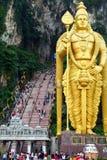 Murugan, Hindu God of war. Lord Murugan Kartikeya, the Hindu God of war, stands guard by the entrance of Batu Caves near Kuala Lumpur, Malaysia. The golden royalty free stock images