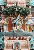 Murugan, Shiva's son, sitting on his knee. Royalty Free Stock Photography