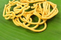 Murukku indian recipe on natural banana leaf. With isolated white background Royalty Free Stock Photos
