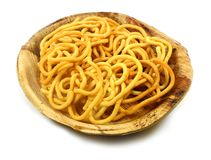 Murukku indian recipe on natural palm leaf plate. With isolated white background Stock Image