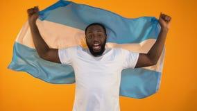 Murzyna falowania argentyńczyka flaga, odświętność sportów drużyny ulubiony zwycięstwo, fan zbiory