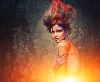 Musa för ung kvinna med kroppkonst Arkivbilder