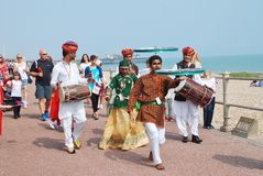 The Musafir Gypsies of Rajasthan. Indian music group, lead the parade along the seafront during the annual St.Leonards Festival at St.Leonards-on-Sea in East Royalty Free Stock Photography