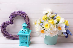 Muscaries and yellow narcissus flowers in vase, heart  and lante Stock Photography