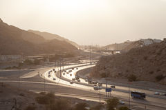 Muscat Expressway at sunset, Oman. Muscat Expressway backlit from the sun in the afternoon. Muscat, Sultanate of Oman stock photography