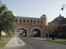 City Gate entering Muscat Old City, Muscat, Oman. A view of the city gate entering in to Muscat old city in Oman, Arabian Peninsula. Watch tower in the Stock Image