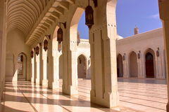 MUSCAT, OMAN: courtyard with arcades at Sultan Qaboos Grand Mosque. Courtyard with arcades at Sultan Qaboos Grand Mosque Royalty Free Stock Images