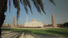 Beautiful view of the Sultan Qaboos Grand Mosque in Muscat, Oman. Panning motion. Muscat, Oman - February, 2019: Beautiful view of the Sultan Qaboos Grand Mosque stock footage