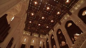 Royal Opera House Muscat. Muscat, Oman - February, 2019: Royal Opera House Muscat. The opera building is inside. Hall decoration, mannequins with traditional stock video footage