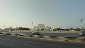 Royal Opera House Muscat. Muscat, Oman - February, 2019: Royal Opera House Muscat. View of the opera building through passing cars stock video