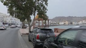 Traffic at corniche in Muscat, Kingdom of Oman. Ð¡ity road along the promenade. Muscat, Oman, - February 2019. Traffic at the corniche in Muscat. The city road stock video footage