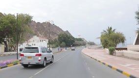 Traffic at corniche in Muscat, Kingdom of Oman. Ð¡ity road along the promenade. Muscat, Oman, - February 2019. Traffic at the corniche in Muscat. The city road stock video
