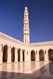 MUSCAT, OMAN: Minaret and courtyard with arcades at Sultan Qaboos Grand Mosque. Minaret and courtyard with arcades at Sultan Qaboos Grand Mosque Stock Image