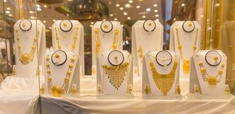Showcase of a jewelry in Muscat, Oman. MUSCAT, OMAN - NOVEMBER 29, 2017: showcase of a jewelry in Ruwi, the commercial district of the capital stock photos