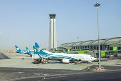 Muscat, Oman, picture dated 31 September 2018 Muscat new airport with Oman air planes. Muscat, Oman, picture dated 31 September 2018 Muscat Oman air planes royalty free stock photography