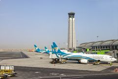Muscat, Oman, picture dated 31 September 2018 Muscat new airport with Oman air planes. Muscat, Oman, picture dated 31 September 2018 Muscat Oman air planes royalty free stock photos