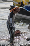 MUSCAT/OMAN 15TH JANUARY 2007 - Omani fisherman drags a shark as Royalty Free Stock Photo