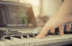 Muscian hand touching Keyboard home studio Royalty Free Stock Images