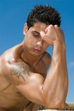 Muscle body of a man under the sky royalty free stock photos