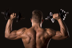 Muscle bodybuilder man lifting weights Stock Photography