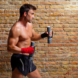 Muscle boxer man with fist bandage and weights. Muscle boxer man with fist bandage and training weights Royalty Free Stock Photo