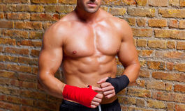 Muscle boxer shaped man with fist bandage Stock Photo