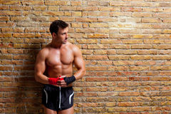 Muscle boxer shaped man with fist bandage Stock Photos