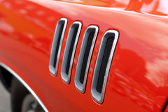Muscle Car Fender Vents. Close up detail of the louvered fender vents on a late model American muscle car with chrome accents Stock Photo