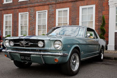 Muscle car Mustang. AMERSHAM, UK - SEPTEMBER 13: A vintage Mustang muscle car is parked on the side of the highway as a static display at the Amersham Heritage Royalty Free Stock Photography
