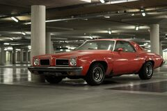 Muscle car parked in garage Royalty Free Stock Photography