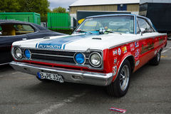 Muscle car Plymouth GTX in the racing coloring. Stock Images
