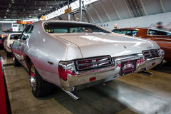 Muscle car Pontiac GTO, 1969. STUTTGART, GERMANY - MARCH 03, 2017: Muscle car Pontiac GTO, 1969. Rear view. Europe`s greatest classic car exhibition `RETRO Royalty Free Stock Photo