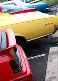 Muscle cars. Colorful classic muscle cars in parking lot Stock Photos