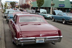 Muscle and Chrome Car Show. SEASIDE, OR/USA - JUNE 16, 2017 - Classic cars line up along Broadway Street for the Muscle and Chrome Classic Car Show on Father`s Stock Photos