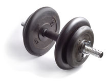 Muscle Maker ver.1. Assembled black rubber dumbbell over white background Royalty Free Stock Images