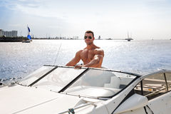 Muscle man on a boat Royalty Free Stock Photos