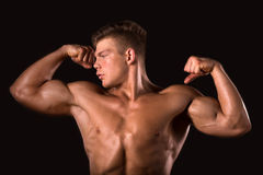 Muscle man bodybuilder showing his biceps Royalty Free Stock Photography