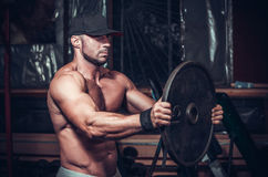 Muscle man in club Stock Images