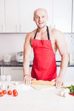 Muscle man cooking Royalty Free Stock Image