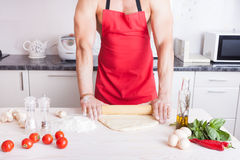 Muscle man cooking Royalty Free Stock Photo