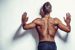 Muscle man dmaking push ups in studio, isolated over a white background Royalty Free Stock Image