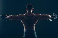 Muscle man doing bicep curls Stock Photography