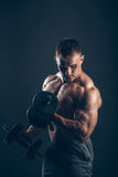 Muscle man doing bicep curls Stock Photo