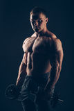 Muscle man doing bicep curls Stock Images