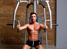 Muscle man exercise on sport gym fitness club. Muscle shaped man exercise on sport gym fitness club in brick wall Royalty Free Stock Photo