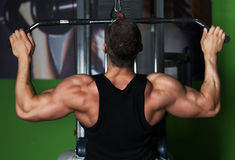 Muscle Man healthy workout exercise in gym. Muscle Man healthy workout exercise in a gym Royalty Free Stock Photo