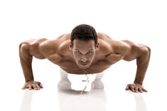 Muscle man making pushups Royalty Free Stock Images