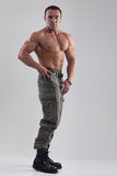 Muscle man in military clothing Royalty Free Stock Image