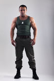 Muscle man in military clothing Stock Photography