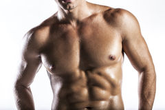 Muscle man. A naked body of European latin muscle man showing off stock photos